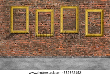 Four golden frames on brick wall - stock photo