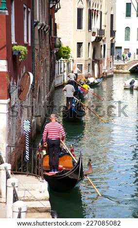 four gondolas in a canal of Venice - stock photo