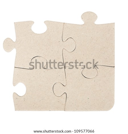 Four gray cardboard jigsaw puzzle piecies isolated on white - stock photo