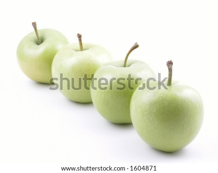 four green apples isolated on white