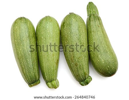 four green zucchinis roll up on white background  - stock photo