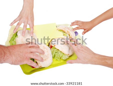 Four hands is about to take a sandwich - stock photo