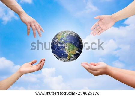 Four hands reaching the world for heal together, save the world concept ,Elements of this image furnished by NASA - stock photo