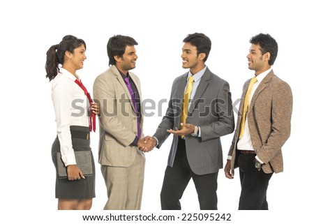 Four happy Indian business people on a white background.  - stock photo
