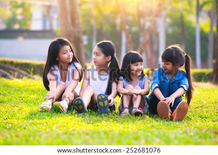 Four happy smiling child playing in park, Outdoor portrait - stock photo