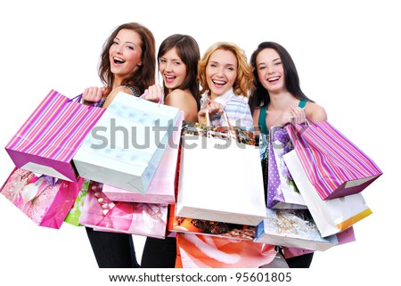 Four happy  women with shopping bags isolated on white