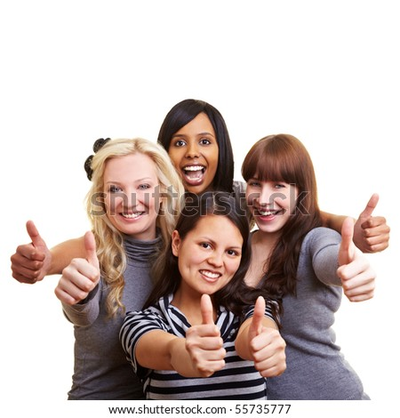 Four happy young women holding their thumbs up - stock photo
