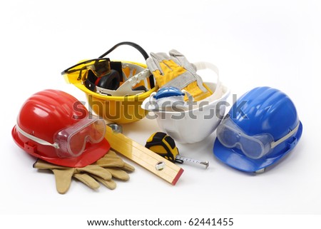 Four helmets- safety gear kit close up - stock photo
