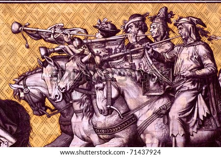 Four heralds on Wilhelm Walter's Fu?rstenzug ('Parade of the Rulers' ) in the Lange Gang in Dresden. It consists of c. 25,000 Meissen porcelain tiles and is the largest tile mural in the world. - stock photo
