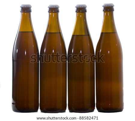 Four  Home Brew beer bottles - stock photo