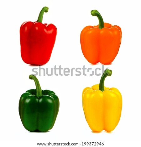 Four isolated bell peppers in red, orange, green and yellow - stock photo
