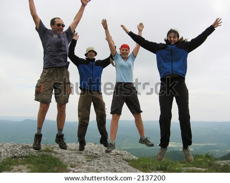 four jumping people - stock photo