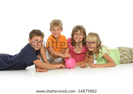 Four kids with piggy bank, isolated on white background - stock photo