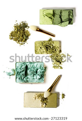 four kind of green color eye shadows with brushes - stock photo