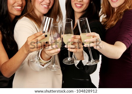 Four Ladies Celebrating with Drinks - stock photo