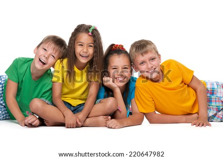 Four laughing children are lying on the white background - stock photo