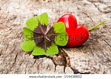 Four Leaf Clover with stone heart - stock photo