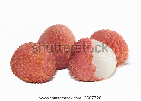 Four litchis - one partially peeled - over white background. - stock photo