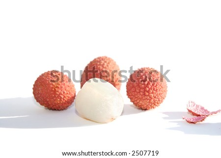 Four litchis - one peeled - on white background - stock photo