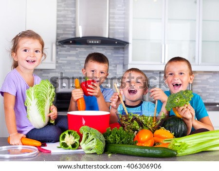 Four little children preparing dinner.  - stock photo