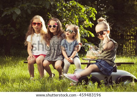 Four little friends have good time together - stock photo