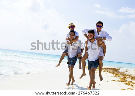 Four male friends at the beach  - stock photo