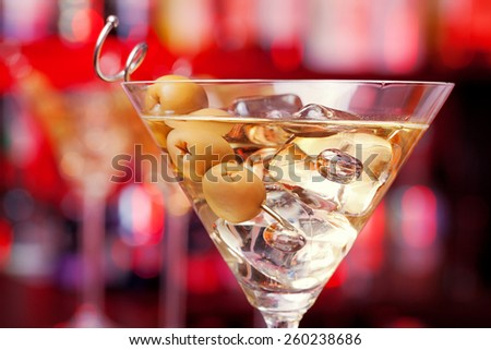 Four Martini cocktails on a bar - stock photo