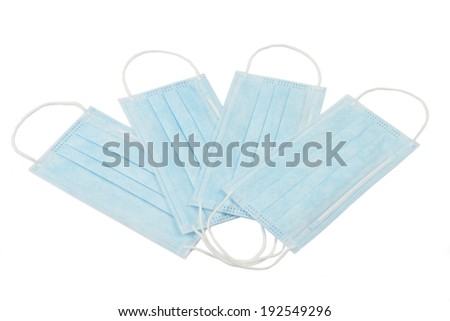 Four medical masks on an isolated background - stock photo