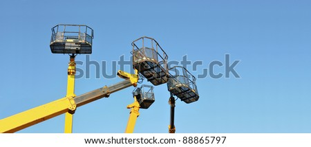 Four mobile platforms elevated towards a blue sky with room for your text - stock photo