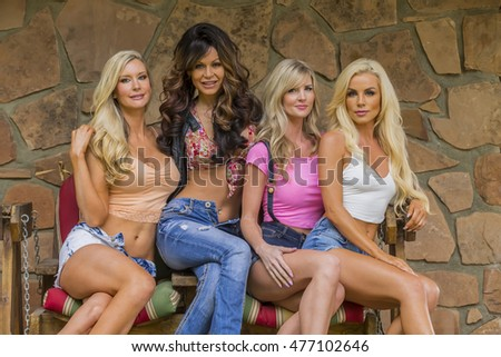Four models pose in an outdoor environment