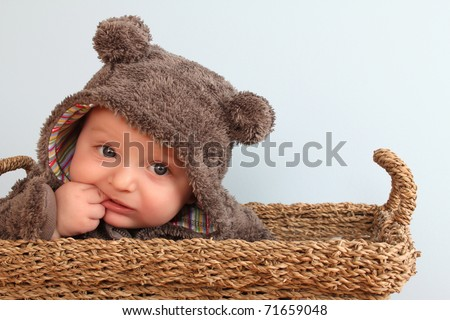 Four month old baby boy wearing a fully bear suit - stock photo
