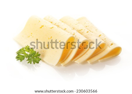 Four neatly folded and displayed Swiss tilsit cheese slices garnished with a sprig of fresh parsley on a white background - stock photo