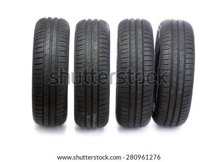 Four new car wheels. Studio, isolate on white background - stock photo