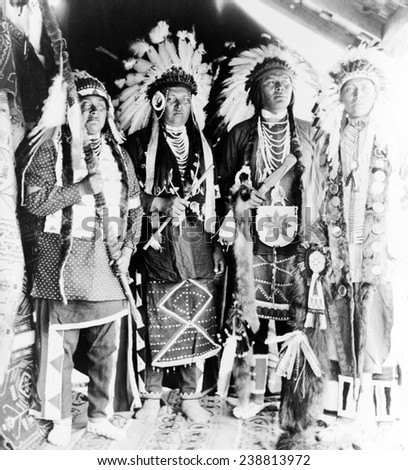 Four Nez Perc_ Indians, dressed for dance, on Colville Indian Reservation, ca. 1910 - stock photo