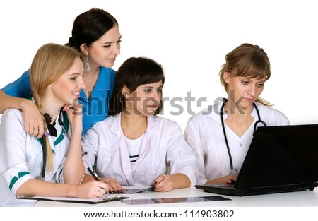 Four nice doctors on a white background - stock photo