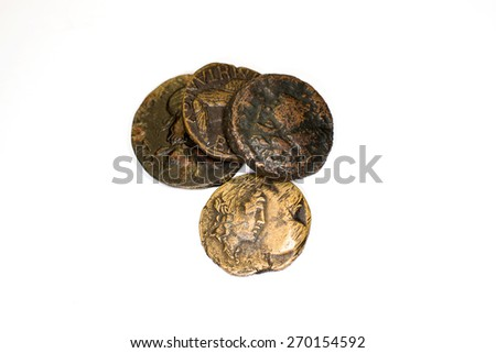 Four old bronze coins on white background