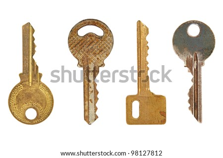 Four old metal keys isolated on a white background.