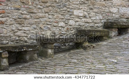 Four Old Stone benches to sit on at an old road in Montechiaro d'Acqui, Piedmont, Italy