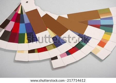 Four open swatch books - stock photo