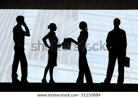 Four outlines of business partners with interacting females in the middle - stock photo