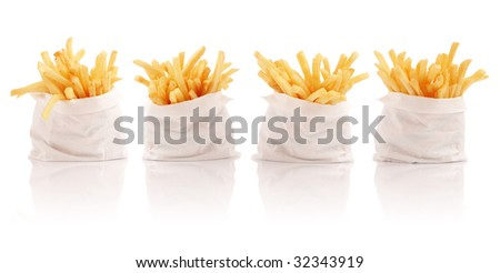 Four packs of french fries - stock photo