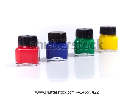 Four paint bottles in prime colors, isolated on white background