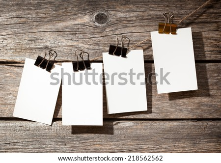 four paper on wooden background  - stock photo