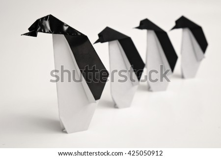 Four penguins origami with white background - stock photo