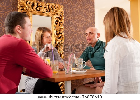 Four people having a debate in cafe