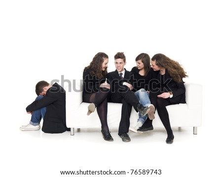 Four people in a sofa rejecting a guy isolated on white background - stock photo