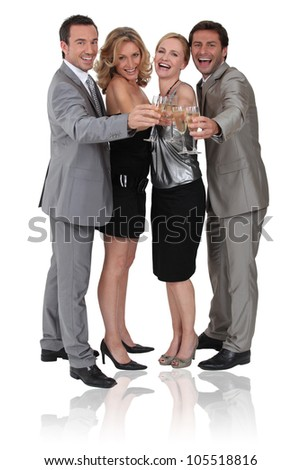 Four persons having a party - stock photo