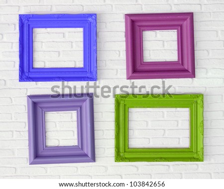 four photo frames on the white wall - stock photo
