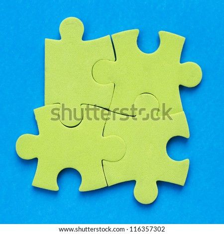 Four pieces of jigsaw puzzle - stock photo