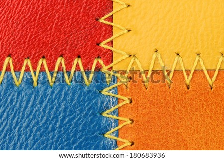 four pieces of leather different color sewn together - stock photo